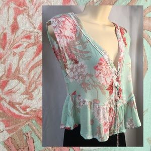 Cute peplum and lace up top in pretty pastels